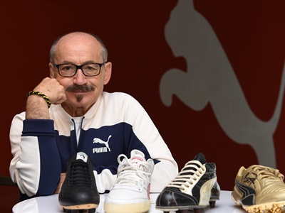 Helmut Fischer with four PUMA shoes