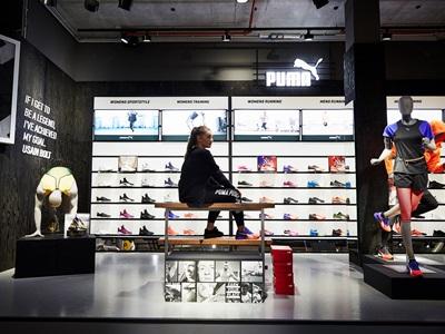 Customer sitting in the PUMA store