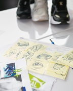 three PUMA sneakers and papers