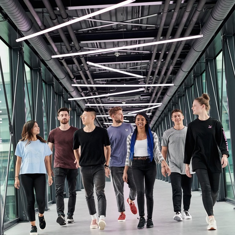seven PUMA employees on the PUMA bridge
