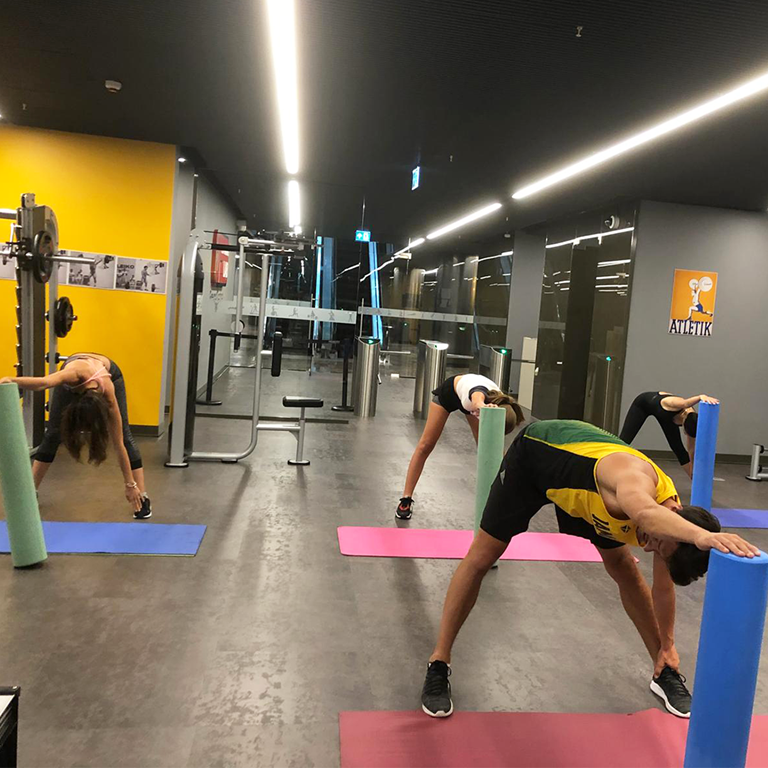 PUMA employees working out