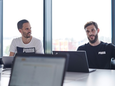 PUMA employees in a meeting
