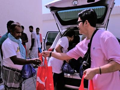 PUMA employees handing bags