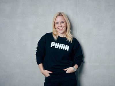 PUMA employee smiling