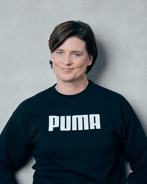 PUMA employee standing