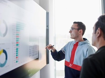 PUMA employees with a screen