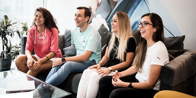 PUMA employees smiling