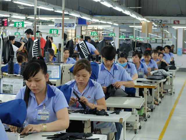 Employees at work in one of PUMA's factories